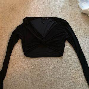 Black knitted long sleeved crop top